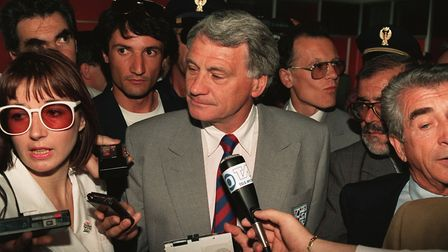England manager Bobby Robson arrives with his squad in Italy for the 1990 World Cup. Photo: PA / Joh