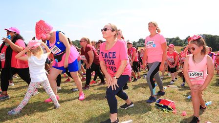Participants warm up before the Stevenage Race for Life 2018. Picture: KEVIN RICHARDS