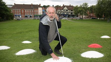 Blind artist David Johnson and his work on display in Hitchin last year. Picture: Danny Loo