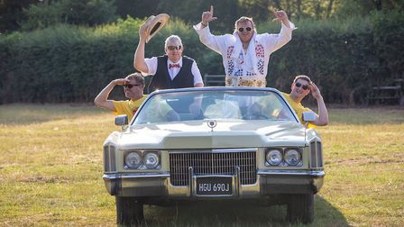 Todd in the Hole Festival co-founders Mark Watts and David Nye with Elvis impersonator Roger Spicer