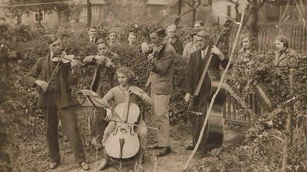 The Berry family play their instruments at Blacksmith's Yard Cottage in Little Wymondley, 1935. Pict
