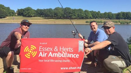 Stevenage MP Stephen McPartland (centre) enjoys a spot of fishing with members of Carping4Charity St