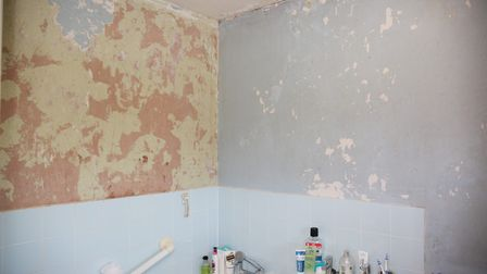 Abby Ellis in her bathroom which has black mould. Picture: DANNY LOO