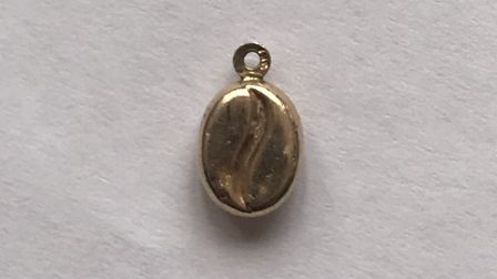 The gold coffee bean officers are looking to reunite with its owner. Picture: Herts police