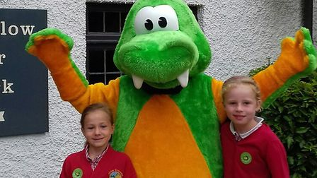Buster the Steposaurus with two Offley Endowed Primary School pupils at the inaugural park and strid