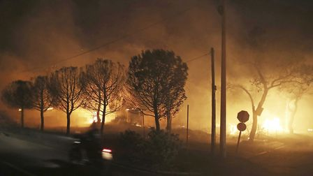 Buildings burn in the town of Mati, east of Athens. Picture: AP/Thanassis Stavrakis