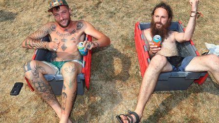 Keeping cool in the afternoon heat by sitting in a box full of ice cold water at Standon Calling Fes