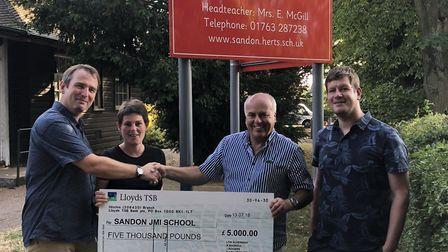 Sandon JMI chair of governors Paul Heath and headteacher Emma McGill were happy to received a check