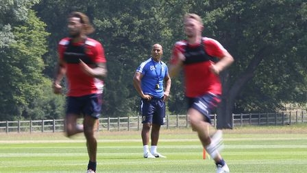 Manager of Stevenage FC Dino Maamria keeps a watchful eye on his players during the first day of Ste