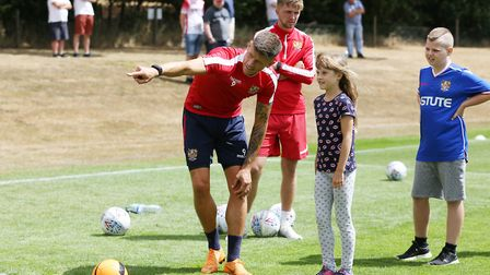 Alex Revell helps a young fan at the Stevenage FC Open Day 2018. Picture: DANNY LOO