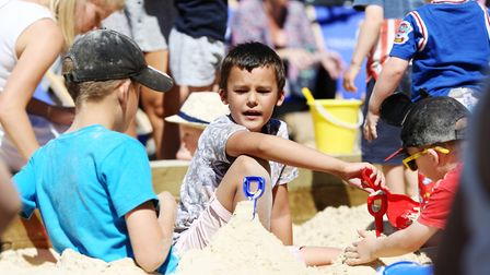 Children enjoying the beach in Hitchin Market Place put on by Gatwards. Picture: DANNY LOO