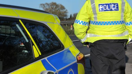 Police have closed Harpenden Road after a crash involving a car and a motorbike.
