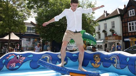 Hitchin Town Centre manager Tom Hardy on the surfing simulator in Hitchin Market Place which is part