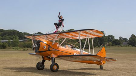 A wingwalker preparing for her display at the Shuttleworth Family Airshow. Picture: Darren Harbar