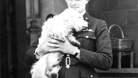 Richard Shuttleworth in his Royal Air Force uniform with his dog Tippy. Picture: The Shuttleworth Tr