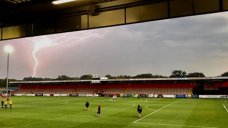 Lightning strikes over Stevenage FC's Lamex Stadium ahead of the friendly against Watford. Picture:
