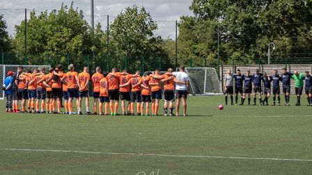 Respectful silence before the charity football match in memory of Stevenage's Mike Quinlan. Picture: