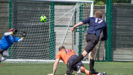 A shot on goal during the charity football match in memory of Stevenage's Mike Quinlan. Picture: DJH