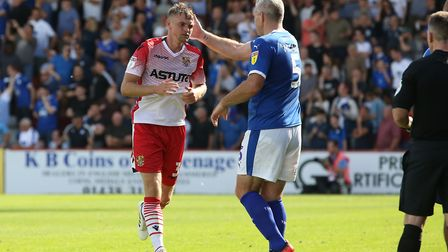 Johnny Hunt of Stevenage leaves the pitch after getting a second yellow card in the League Two game