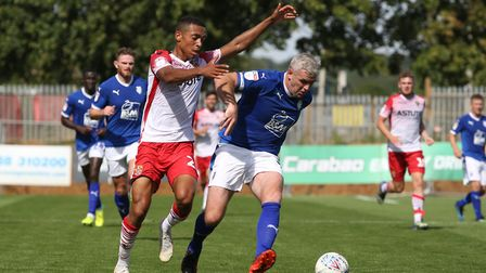 Alex Reid of Stevenage tussles with Steve McNulty of Tranmere Rovers in the League Two game between