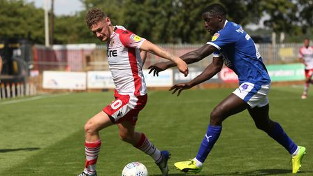 Ben Kennedy of Stevenage holds off Zoumana Bakayogo of Tranmere Rovers in the League Two game betwee