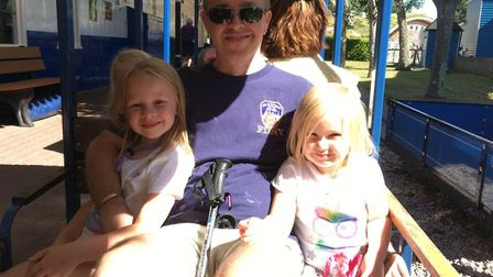 Scott Everett with his daughters Anna and Evie, enjoying a family day out thanks to a grant from the