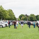 Visitors admire the vintage cars at the show