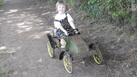Mrs Hopper sent in this picture of her daughter on a vintage Triang De Dion pedal car. Picture: J Ho
