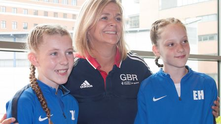 National head trampoline coach Tracy Whittaker-Smith with HBS Revolutions gymnasts Zoe Cooper and Em
