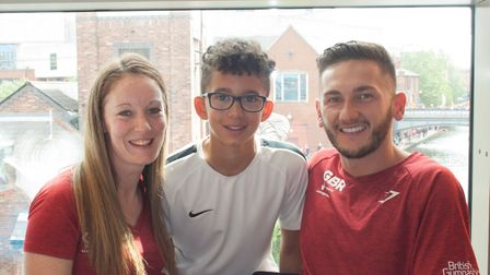 Trampoline gymnasts Kat Driscoll and Luke Strong with HBS Revolutions' Jamie Bridge, centre. Picture