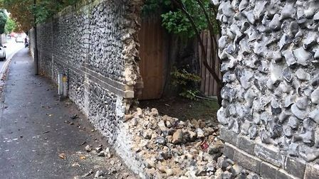 It is believed the car spun out and crashed through the wall. Picture: SIMON CURTIS