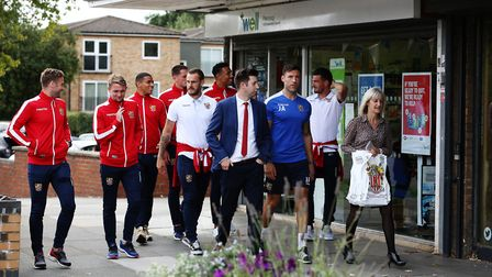 Stevenage FC CEO Alex Tunbridge and first team players take to the streets of Stevenage to deliver s