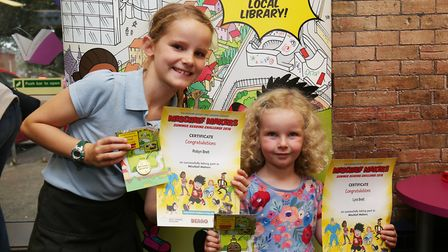 The Brett family receive their certificates and medals after completing the Summer Reading Challenge