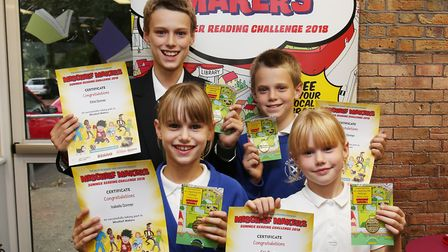 The Dormer family receive their certificates and medals after completing the Summer Reading Challeng