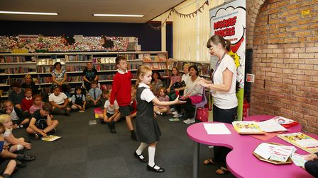 Children receive their certificates and medals after completing the Summer Reading Challenge at Hitc