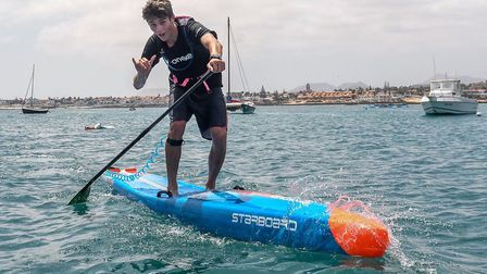 Ben Moreham at the end of a 12km stand-up paddle course. Picture: Alex Moreham