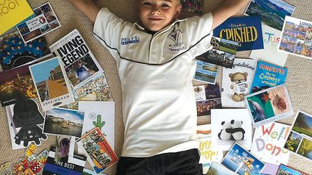 Max Rowlandson with all the cards he has received from around the world. Picture: CONTRIBUTED