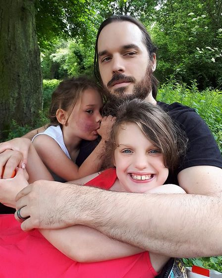 Luke Costa, with two daughters Phoenix and Willow. Picture: Jade Costa
