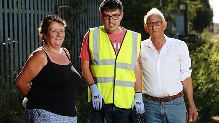 Christopher McDaid, with long-term carers Sally Rowling (left) and John Rowling (right), has taken i