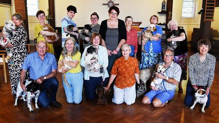 The pets and their owners with Rev Melanie Crowley, wearing orange, at the annual pet-blessing servi