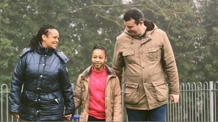 A still from Herts county council's film, showing the character of Shanice with her foster parents.
