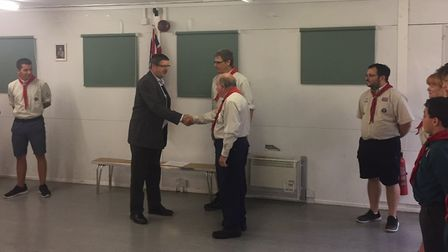 Crane BS&U president Richard Tuck presents a donation to the 8th Letchworth Scout Group. Picture: Cr