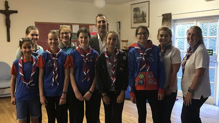 Crane's Scott Dalrymple, centre, with the 11th Hitchin (Holy Saviour) Guides in the Holy Saviour Chu