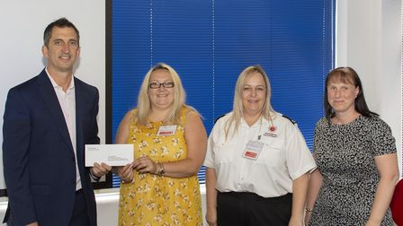Crane's Scott Dalrymple hands over a donation to the Fire Fighters Charity. Picture: James J. Harris