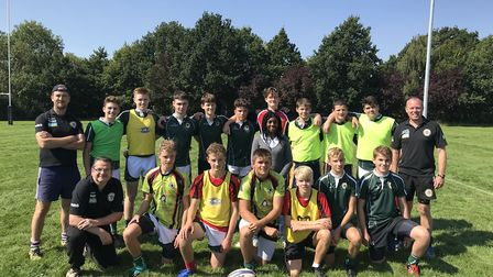 Kemi Badenoch MP with some of the under-16 players and coaches at Saffron Walden RFC