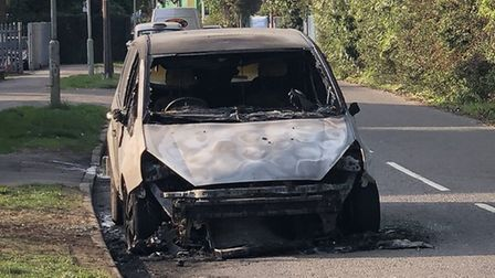 The burnt-out car in Hitchin's Bury Mead Road. Picture: Stefan Hill