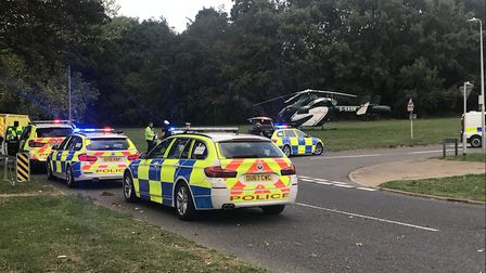 An air ambulance, police and ambulance service personnel at the scene of the crash in Lonsdale Road