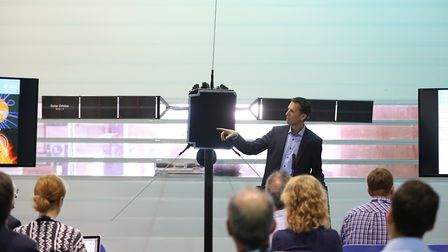 Dr Daniel Muller speaks in front of a model of the European Space Agency's Solar Orbiter at Airbus i