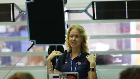 Prof Louise Harra speaks in front of a model of the European Space Agency's Solar Orbiter at Airbus