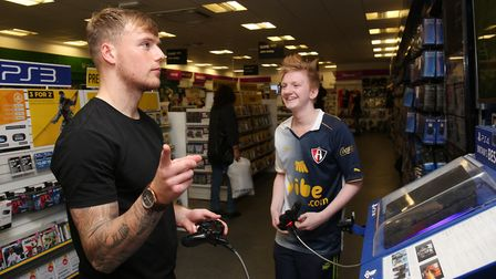 Stevenage FC player Tom Conlon celebrates scoring a goal against a fan on FIFA 18 during last year's